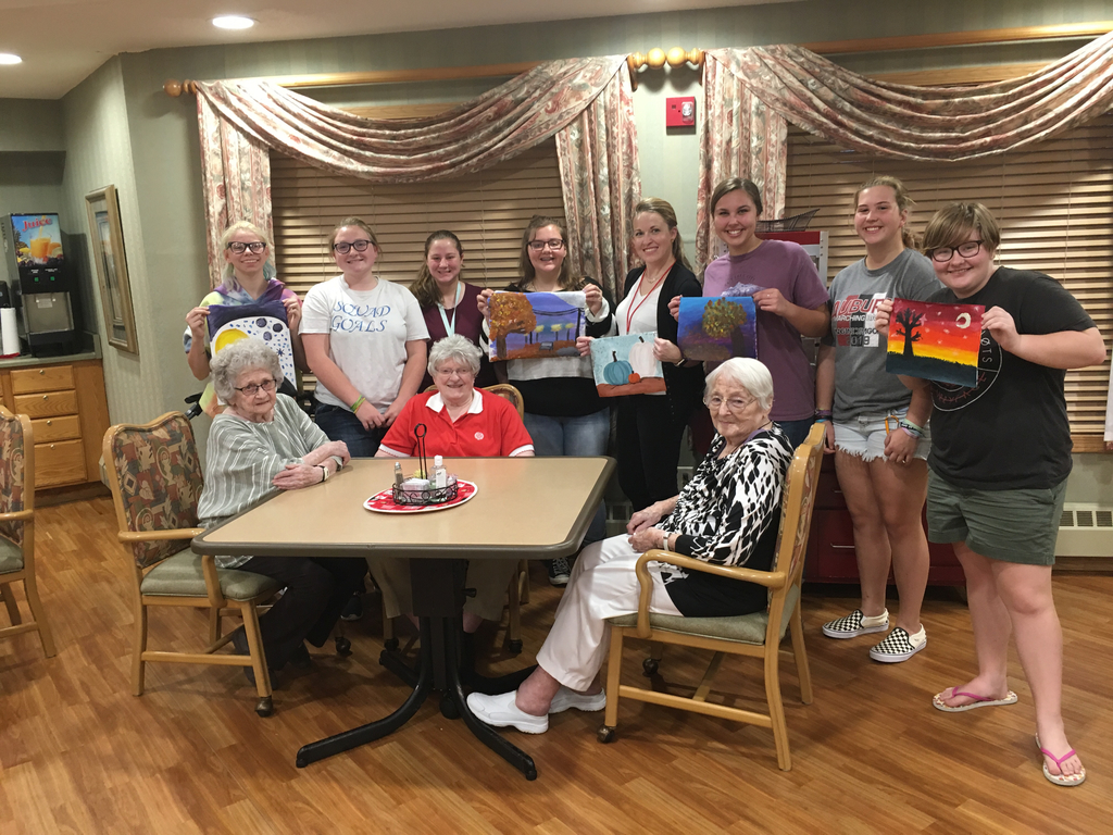 Art club painting with Longs Creek Village residents