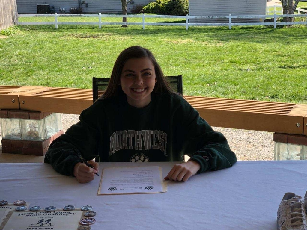 Faith Allgood signs with NWMSU!